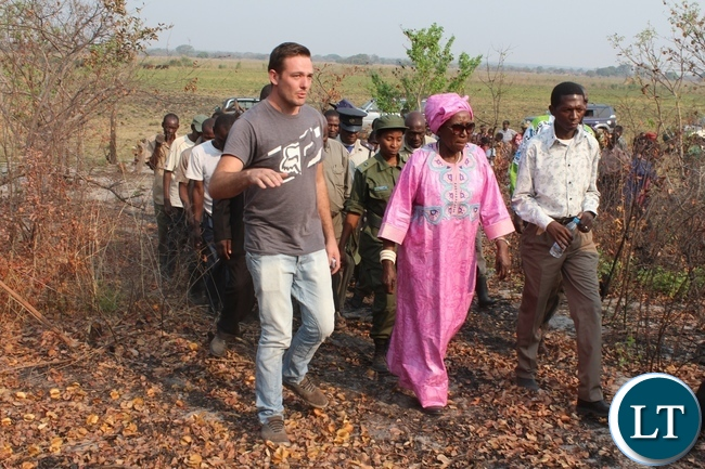 The Zambia Project Site Manager Jaycee Coetee (r) showing Vice President Inonge Wina (l) the site for the construction of a clinic by Dignity Zambia, a charitable organization based in Australia, in Nalolo District