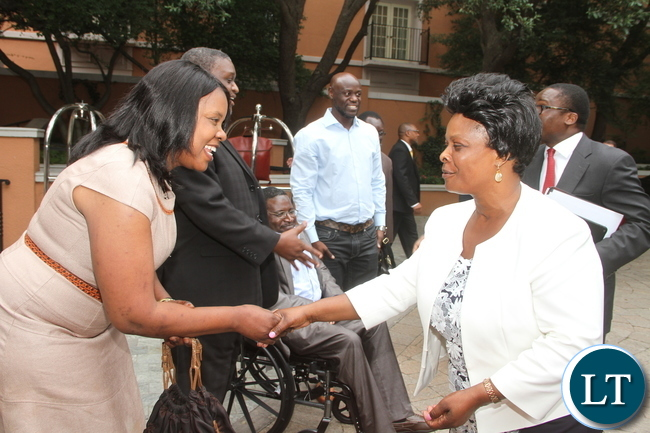 First Lady Esther Lungu greets a Zambian living in Dallas-Texas Namunji Isimwaa (L) on arrival in Dallas-Texas for the Global Women's network summit organized by the George W. Bush Institute on Sunday, September 20,2015 -Picture by THOMAS NSAMA