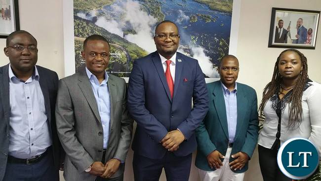 Emmanuel Mwamba with members of their steering committee