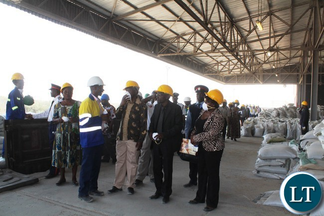 Nitrogen Chemicals of Zambia Chief executive Zuze Banda explains a point to Commerce Trade and Industry Permanent Secretary, Siazongo Siakalenge ,while District agriculture coordinator ,Mwanji Chela,(right)listens.