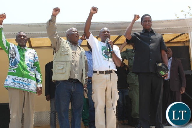 President Edgar Lungu with PF Lubanseshi candidate George Mwansa when he address a huge rally at Mucheleka school today. looking on is campaign manager Freedom Sikazwe, Mwansabombwe MP Rogers Mwewa and Senior Private Secretary to the President Danniel Sio :Picture by Mary Bwembya (ZANIS)