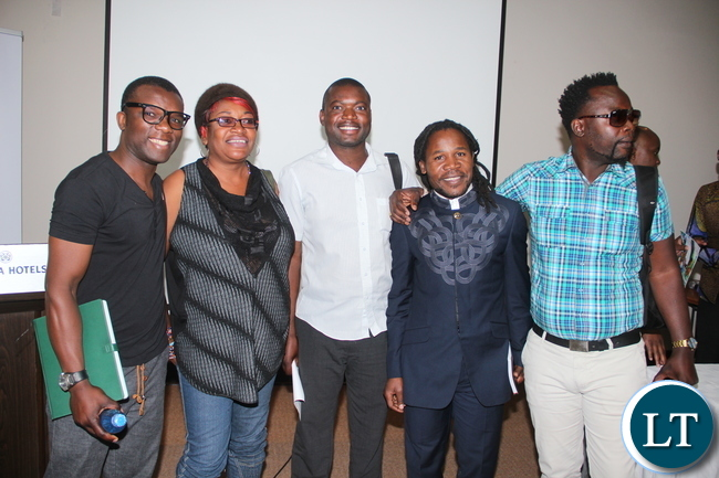 Zambia Association of Musicians, president, Njoya Tembo and other artists, take a group photo.