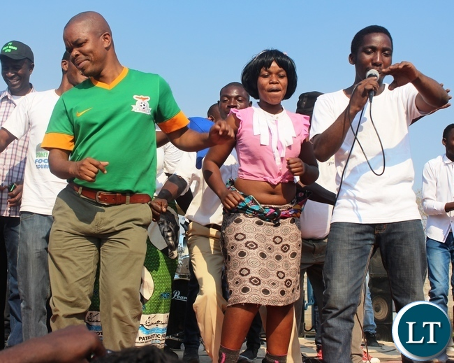 Education deputy Minister Sydney Mushanga (left) joins Evelyn Hone College Band during the Sydney Mushanga sports tournament in Bwacha compound in Kabwe recently.