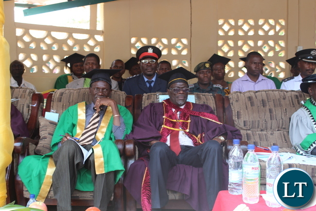 "AGRICULTURE and Fisheries Permanent Secretary Dr David Shamulenge(seated Right) and Monze District Commissioner Mr. Cyprian Hamanyanga(seated left) watch proceedings at the Zambia College of Agriculture's (ZCA) 4th Diploma and 64th Certificate General Agriculture graduation ceremony held under the theme, ""Continued Innovation and Quality Agriculture Training Beyond the Golden Jubilee Year"" in Monze"