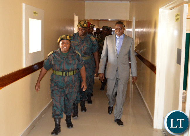 DEFENCE deputy Minister Christopher Mulenga (in a suit) being taken on a tour of the Zambia National Service Clinic in Choma