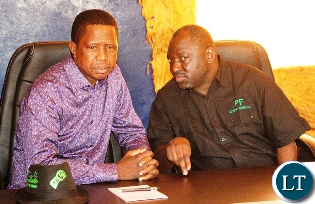 President Edgar Lungu confers with Secretary General of Patriotic Front Davies Chama before he paid a courtesy to Chief Matebo of the Kaonde people from Solwezi West.