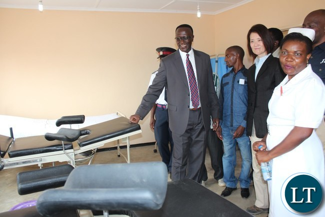 EASTERN Province Permanent Secretary, Chanda Kasolo, admires the beds in the maternity ward of Dwankhozi health post during the tour of the facility after it was handed over By JTI on Thursday. Looking on are health post Sister-In-Charge, Beauty Jere and Japan Tobacco Senior Vice President, Ryoko Nagata