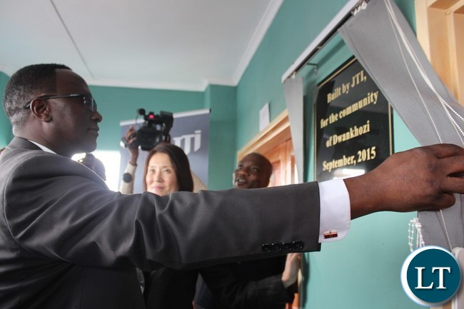 EASTERN Province Permanent Secretary, Chanda Kasolo, unveils a plaque after he officiated at the handover of a health post at Dwankhozi in Chipangali constituency on Thursday. The facility was byuilt by Japan Tobacco International as part of the Social Corporate Responsibility.