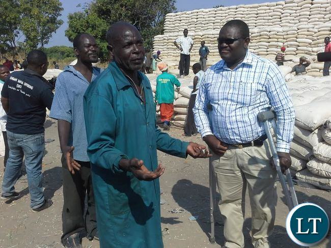A peasant farmer Chileshe Binwell has delivered 80 bags at the Food Reserve Agency Lwimbo depot in Kasama. Here, Mr Chileshe (left) confers with FRA chief Chola Kafwabulula (right) with whom he shared some of the challanges that include inadequate scales