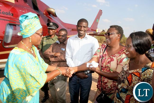First Lady Esther Lungu being welcomed by Central Province Permanent Secretary Edwidge Mutale on arrival in Itezi Tezhi for the continued outreach Programme for People with Special needs hon Sunday, September 6,2015 . Looking on is Agriculture deputy minister Greyford Moonde -Picture by THOMAS NSAMA