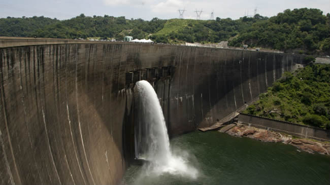 Flood gates on the Kariba Dam wall between Zimbabwe and Zambia open ceremonially on February 20, 2015 after the two neighbors signed $294 million in deals with international investors - JEKESAI NJIKIZANA/AFP/Getty Images