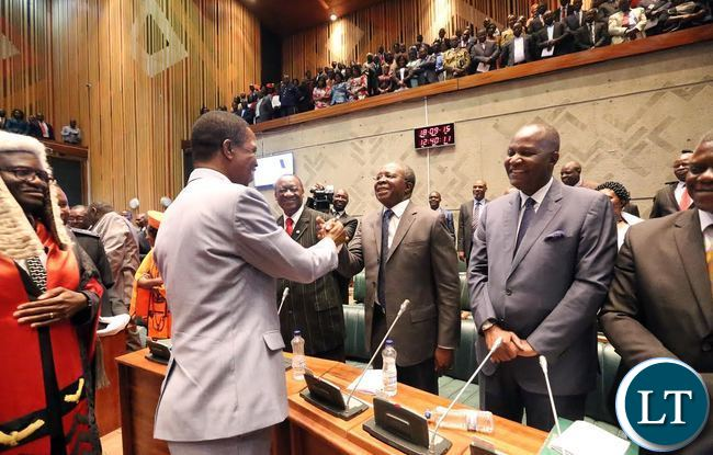 President Lungu (Right) greets opposition members of Parliament after addressing the Fifth Session of the Eleventh National Assembly in Lusaka on Friday, 18th September 2015. Picture by EDDIE MWANALEZA/STATE HOUSE
