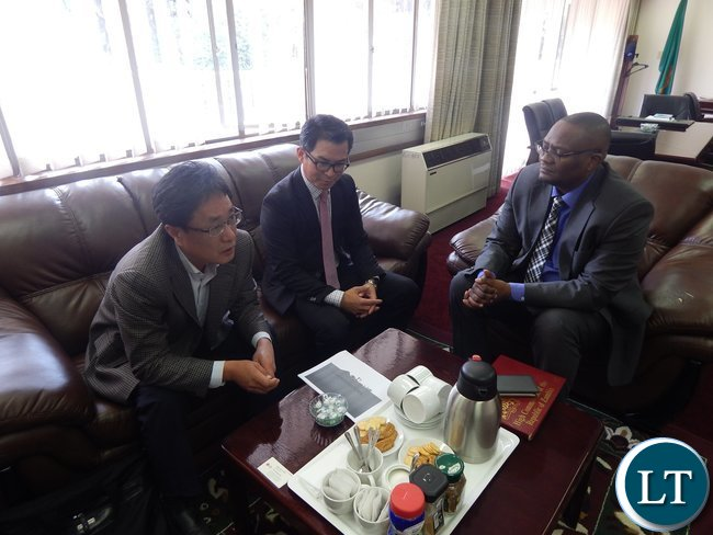 High Commissioner His Excellency Mr. Mwamba with representatives from KEPCO KPS, Mr. Jason Lee (left) and LG International, Mr. Dow Lee during the meeting at the High Commission in Pretoria