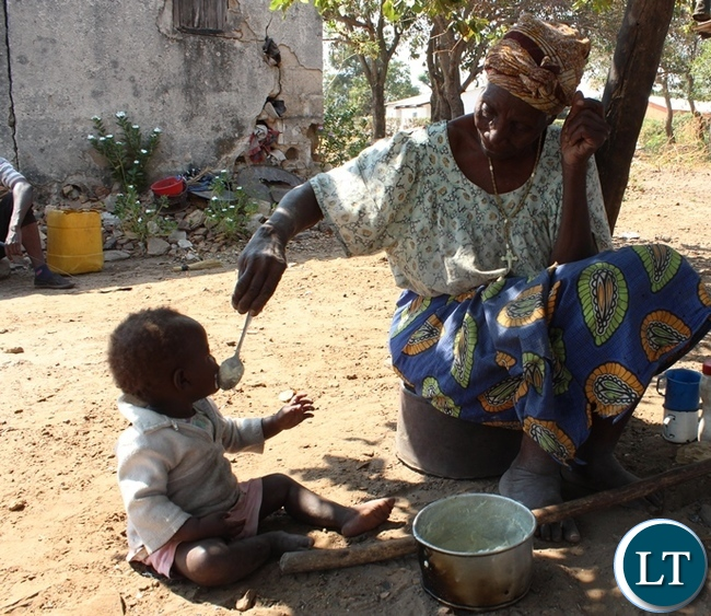 Theresa Chilambwe 90 and Veronica Chilambwe 96, with their great grand children Gladys Chola 6, Isaac Chanda 4 and Easter Chilambwe left by her granddaughter at her residence in Mulenga Hills Village in Kasama . The Family is appealing to well-wishers to help her renovate her house which is on the verge of collapsing