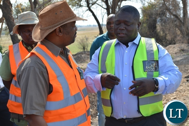 Zambia's Transport, Works, Supply and Communication Minister Yamfwa Mukanga (right) and Botswana Minister for Transport and Communications Tshenolo Mabeo (left) during an inspection of Kazungula Bridge project