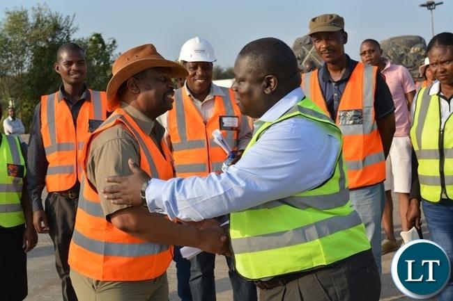 Zambia's Transport, Works, Supply and Communication Minister Yamfwa Mukanga (right) hugs Botswana Minister for Transport and Communications Tshenolo Mabeo (left) during an inspection of Kazungula Bridge project