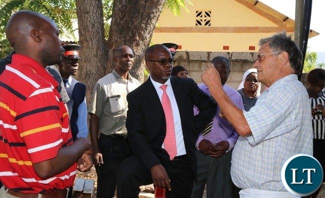 A team of Engineer's laid by Lusaka Province Permanent Secretary Stardy Mwale (C) listen's to Mphanshya Mission Hospital DR in charge Mathias Furrer during the PS tour of the hospital