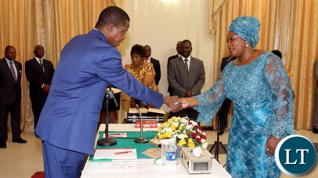 President Edgar Lungu swears in Petauke member of Parliament Dora Siliya as Energy and Water Development Minister. The President has also sworn in Livingstone Central member of Parliament Lawrence Evans as Deputy minister of Livestock and Fisheries at State House on Friday 16-10-2015- Pictures By Eddie Mwanaleza/Statehouse.