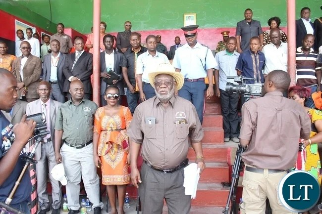 Labour Minister Fackson Shamenda (c) before delivering his key note speech during the 51st Independence Anniversary celebrations at Mongu Sports Stadium
