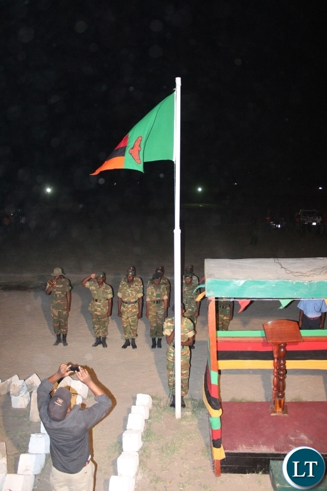 ambia Army raising the flag to mark the 51st Independence Anniversary at Mongu Sports Stadium on Friday midnight.
