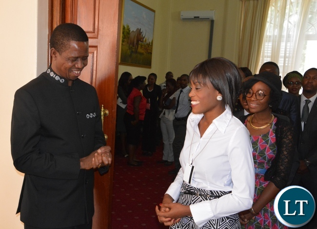 President Edgar Lungu chats with Kawambwa District Magistrate Nandipha Ngulube at State House during the meeting with Mandela Washington Fellowship of young African Leaders
