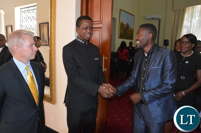 President Edgar Lungu chats with Brian Bwambya (Bflow) whilst USA Ambassador Eric Schultz at State House looks on during the meeting with Mandela Washington Fellowship of young African Leaders