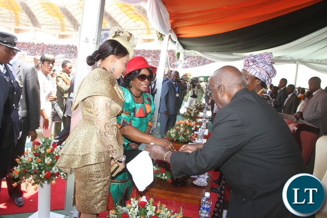 First Lady Esther Lungu with Swaziland First Lady greets  First Republican president Dr Kenneth Kaunda during  Zambia's 51st  Independence Day celebrations at Heroes Stadium  in Lusaka on  Saturday, October 24,2015 -Pictures by THOMAS NSAMA
