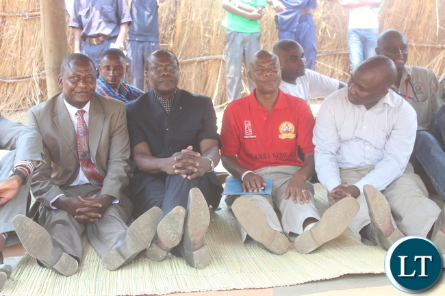 (L to R ) Central Province Minister Davis Chisopa,Justice Minister Ngosa Simbyakula,Chibombo District Commissioner Felix Mangwato and Central Province Deputy Permanent Secretary Ronald Sinyangwe seat on a reed matt during the Kulamba Kubwalo Traditional Ceremony.