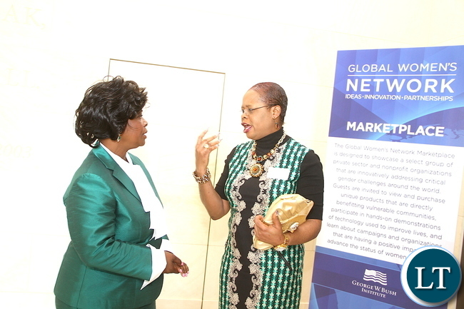 First Lady Esther Lungu talks Princess Nikky  Onyeri, founder of the Breast Cancer Foundation   after attending  the First Ladies roundtable : improving maternal and Child Health  conference in Africa in Dallas , Texas  on Monday, September 21,2015  -Picture by THOMAS NSAMA
