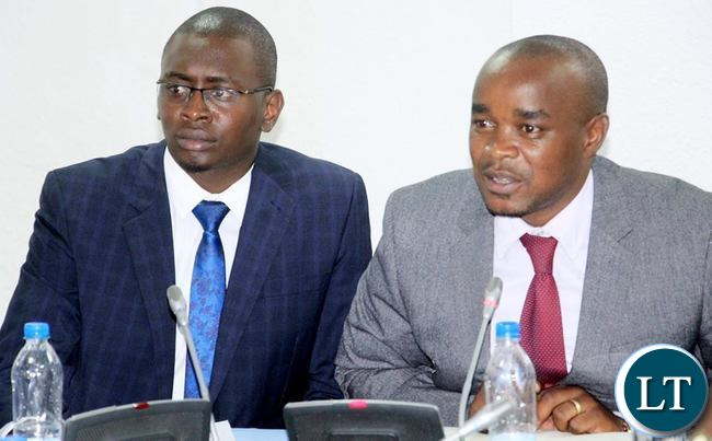 William Chilufya flanked by Communications Officer Eneya  Phiri appearing before the Expanded Estimates Committee at Parliament