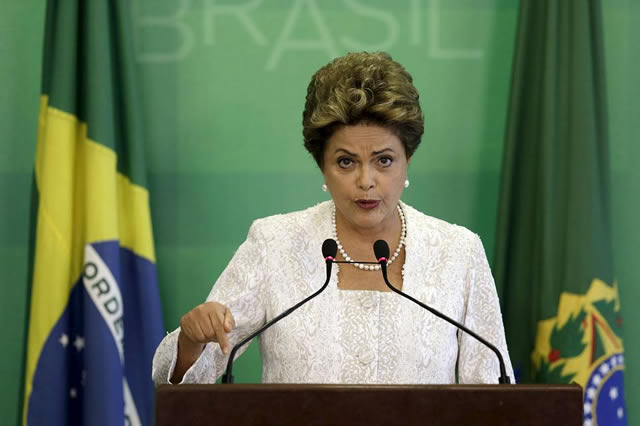 Brazil's President Dilma Rousseff axed eight ministries and announced salary cuts, including her own, in a cost-cutting measure as the country looks to stabilize its economy. PHOTO: REUTERS