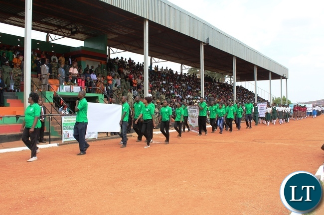 MARCHERS march past the guest of honour, Minister of Youth and Sport, Vincent Mwale, during the 51st Independence celebrations held at David Kaunda stadium in Chipata