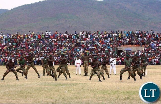 SOLDIERS from the fourth Battalion at Gondar Barracks demonstrate defense techniques during an encounter with enemies. This was during the 51st Independence celebrations held at David Kaunda stadium