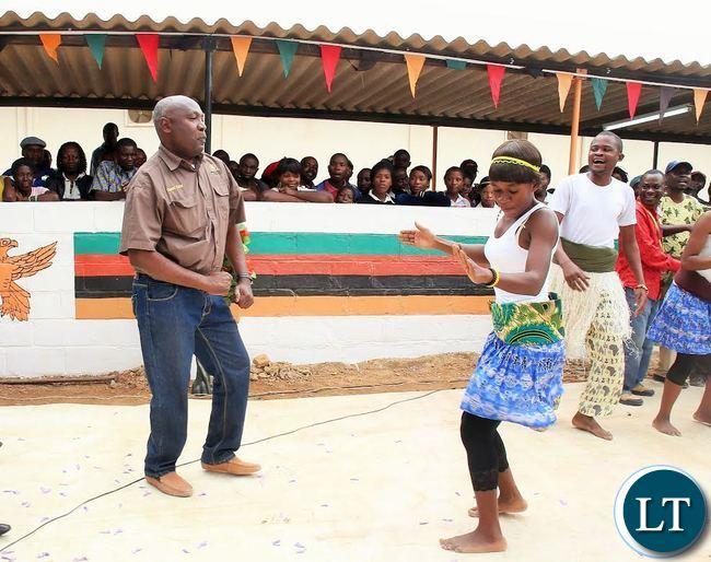 LUAPULA Province Permanent Secretary Boniface Chimbwali dancing with a member of Chilikuli iwe drama group at Mansa General Hospital during the open day celebrations