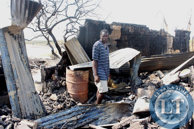 Mwendabai Lutopu going through the remains of his burnt house in Imuba Village of Katongo Lower area in Mongu after the whole village had been burnt to ashes.