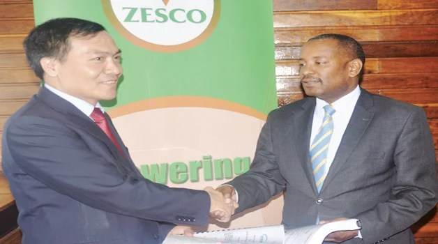 ZESCO acting managing director Victor Mundende (right) exchanges documents with Sinohydro Corporation Limited vice-president Liu Kai. This was during the signing of a contract for the construction of the Kafue Gorge Lower hydro power plant.