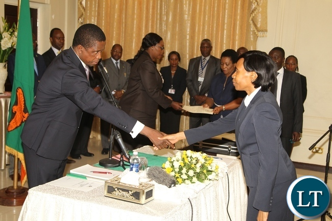 President Edgar Lungu congratulates Kayula Siame shortly after swearing in ceremony at State House Yesterday 20-11-2015. Picture by ROYD SIBAJENE/ZANIS