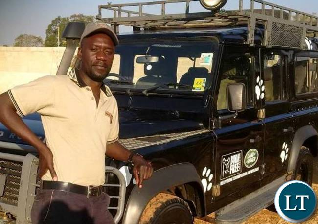 Cosmas Mumba by the ZPP car and while releasing a yellow baboon. Photo: GRI – Zambia Primate Project