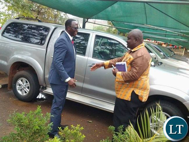 Eastern Province Permanent Secretary Chanda Kasolo sharing a light moment with Chipata District Commissioner Kalunga Zulu after handover ceremony of the newly procured vehicle for the District Commissioners in Eastern Province in Chipata
