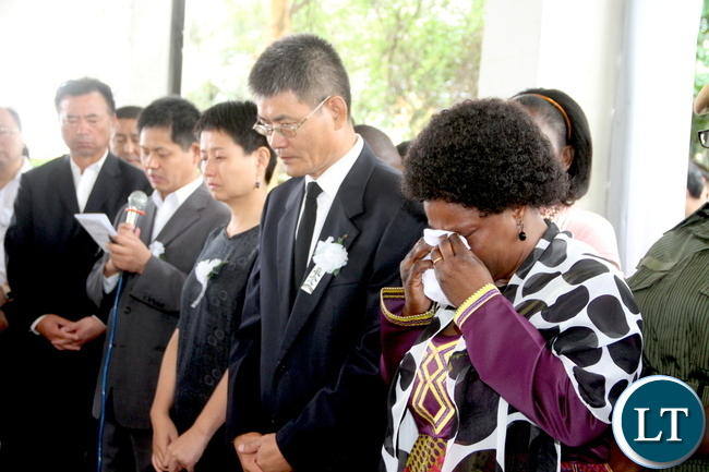First Lady Esther Lungu breaks down during the burial of the three Chinese nationals who were murdered on the Copperbelt. This was at Kitwe-Chingola road Cemetery in Kitwe on Tuesday, November 3,2015 -Picture by THOMAS NSAMA
