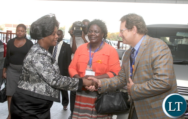 First Lady Esther Lungu being welcomed by African Union Head of Division Social Welfare, Vulnerable Groups Drug Control and Crime prevention Department of Social Affairs Dr Johan STRJDOM at the movies on End Child Marriage . This was during the First African Girls Summit on Ending Child Marriage in Arica at Government Complex in Lusaka on Wednesday, November 25,2015 -Picture by THOMAS NSAMA