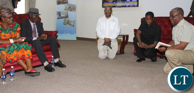 President Edgar Lungu greetings the chiefs on his right ZESCO Acting MD Victor Mundende and on his left Southern Provincial Minister Nathanael Mubukwanu.