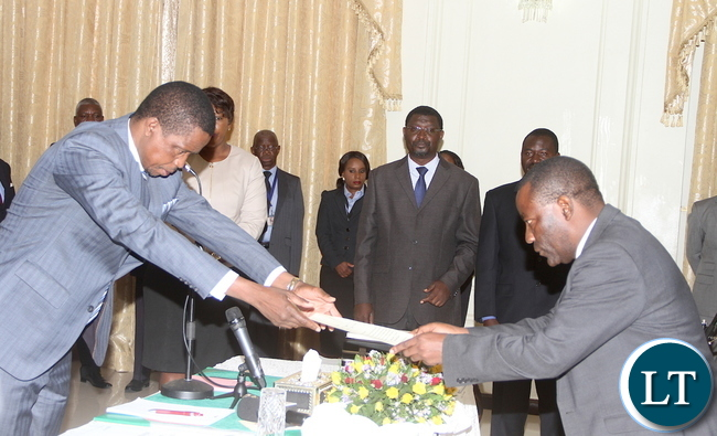 President Lungu receives an affidavit of Oath from newly appointed Commerce deputy minister Raymond Mpundu during the swearing-in-ceremony at State House on Tuesday, November 10,2015 -Picture by THOMAS NSAMA