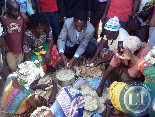 UPND president Hakainde Hichilema helping the women in Matero