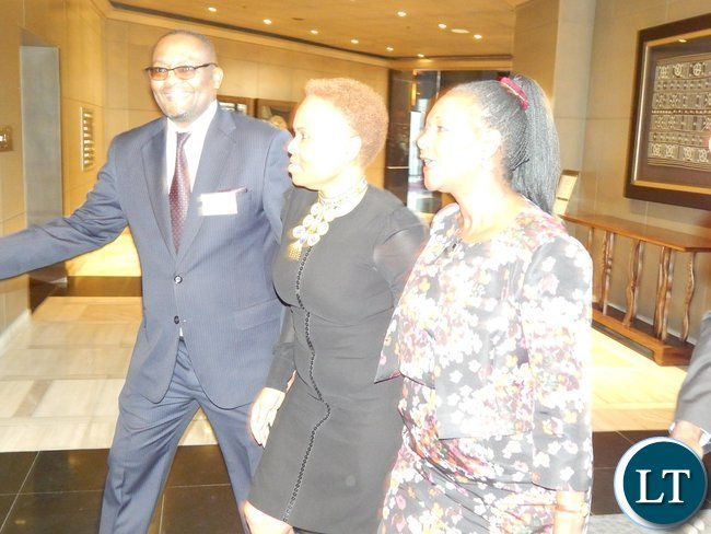 Mr. Emmanuel Mwamba, South Africa's Minister for Small Business Development, Lindiwe Zulu and Zambia's Minister of Commerce, Trade and Industry, Mrs. Margaret Mwanakatwe arrive at the launch of the Zambia-South Africa Business Council in Johannesburg