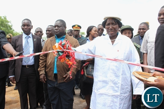Acting President Inonge Wina (r) cutting the ribbon as Works and Supply Minister Yamfwa Mukanga (l) looks on during the launch of Countrywide Feeder Roads Rehabilitation Project worth K16.2 billion in Litoya area of Nalolo District in Western Province