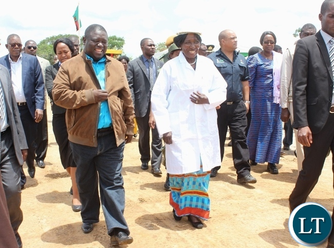 Acting President Inonge Wina (r) with Works and Supply Minister Yamfwa Mukanga (l) at the launch of Countrywide Feeder Roads Rehabilitation Project worth K16.2 billion in Litoya area of Nalolo District in Western Province