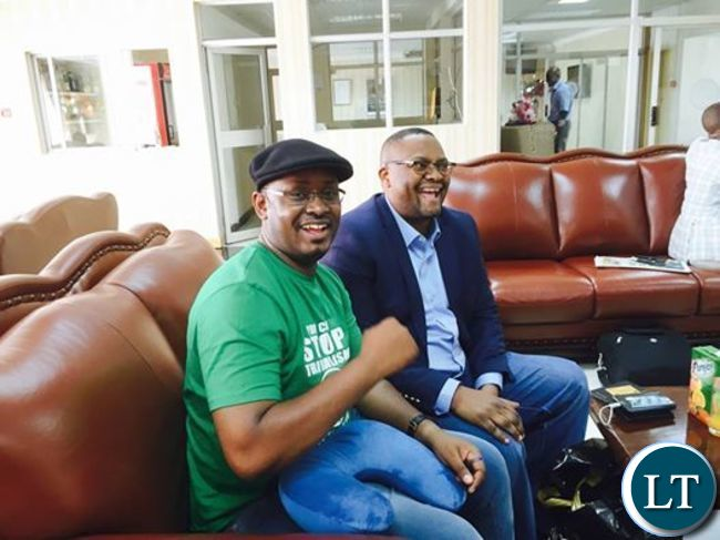 Ambassador Mwamba shares a light moment with PF official   Sunday Chanda at KKIA on Tuesday before departure for South Africa