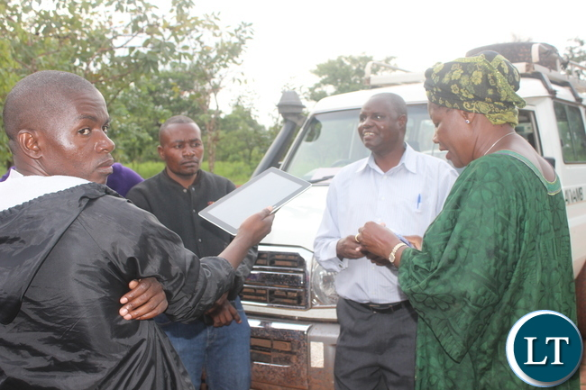 President Nawakwi talks to the officer -in - charge