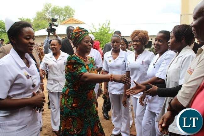 FIRST Lady Esther Lungu (2nd left) greets Linda clinic staff while Nurse In-Charge Memory Hamaleka (left) does the introductions at Linda clinic in Livingstone